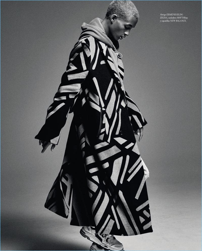 Taking to the studio, Jaden Smith dons an Ermenegildo Zegna coat, MSFTSrep sweatshirt and New Balance sneakers.