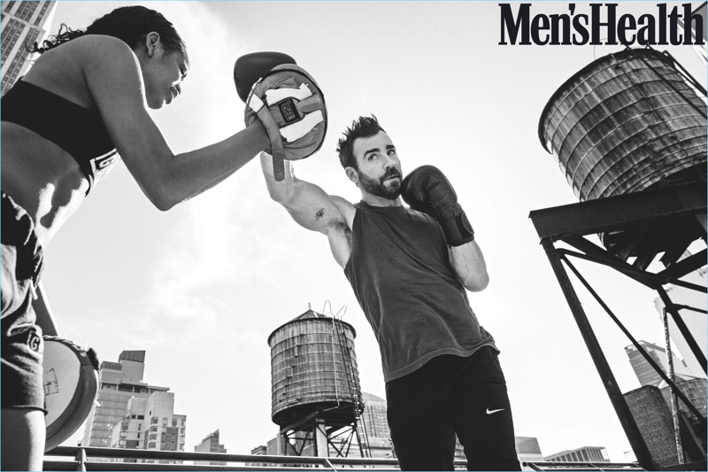 Working out, Justin Theroux wears a Kelly Cole t-shirt with Nike pants.
