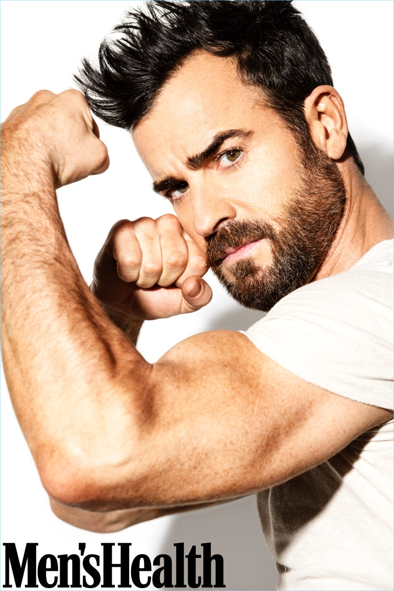 Actor Justin Theroux flexes his bicep for the pages of Men's Health.