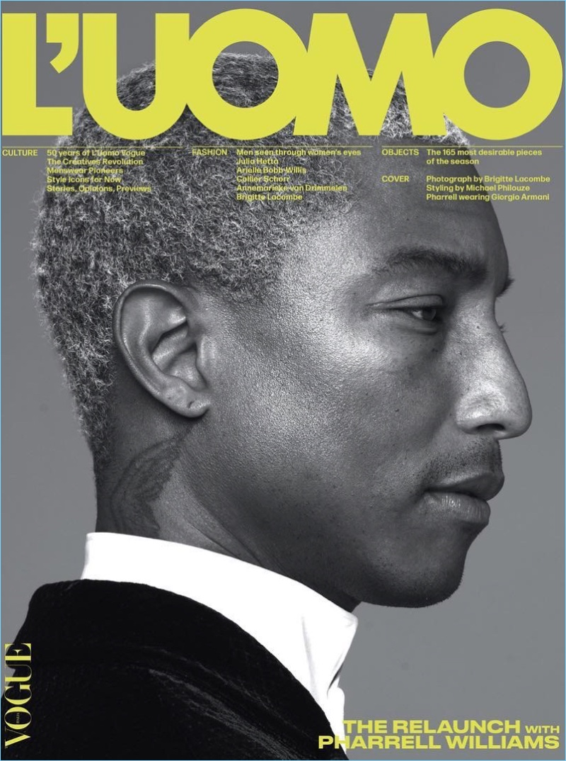 Pharrell Williams covers L'Uomo Vogue in Giorgio Armani. Delivering a side profile, Pharrell is photographed by Brigitte Lacombe with styling by Michael Philouze.