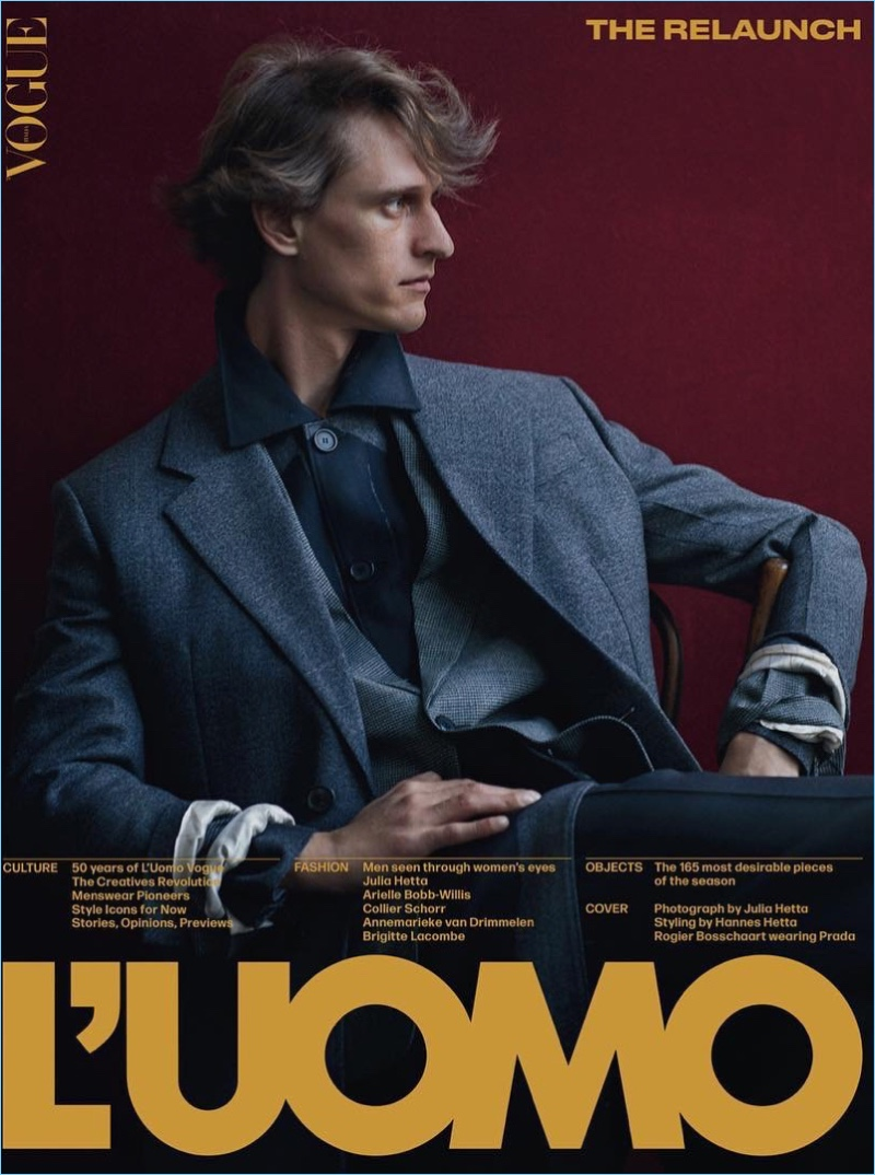 Rogier Bosschaart covers L'Uomo Vogue in Prada. The Dutch model is photographed by Julia Hetta with styling by Hannes Hetta.