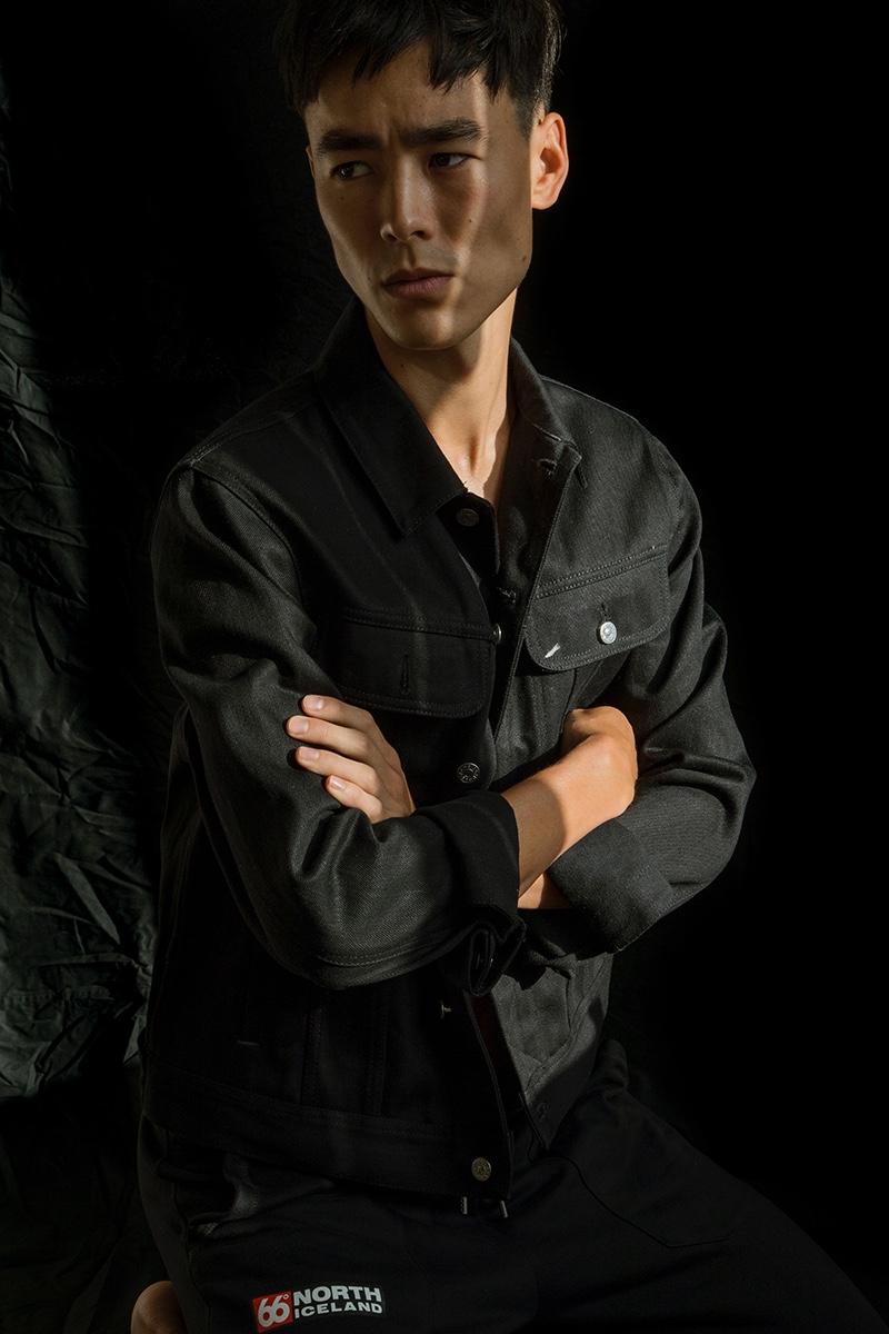 Mihn wears denim jacket Acne Studios and pants 66North.