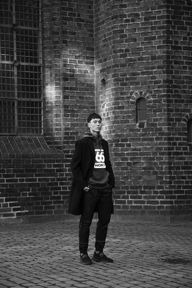 Mihn wears jacket Acne Studios, hoodie 66North, pants Newline Halo, and shoes Nike.