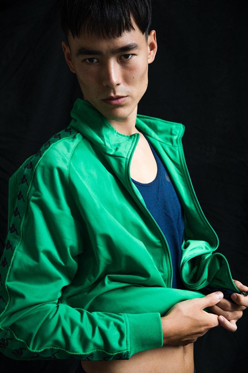 Mihn wears tank Nike and jacket Kappa.