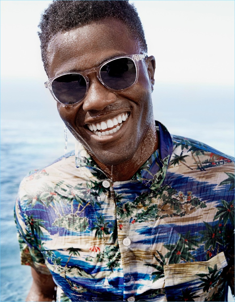 All smiles, Remi Alade-Chester wears Warby Parker's Topper Wide sunglasses.