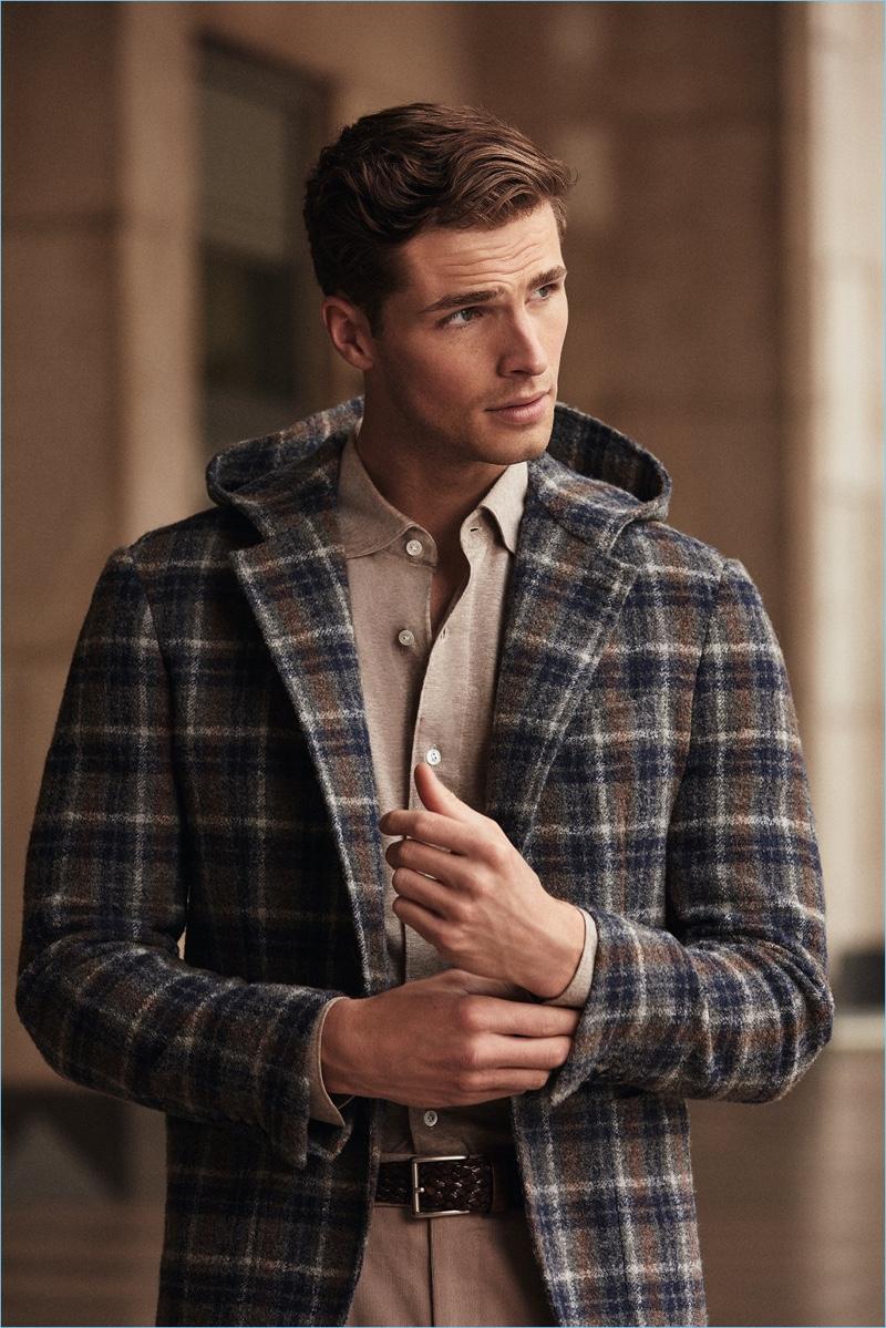 British model Edward Wilding sports a check Belvest coat.