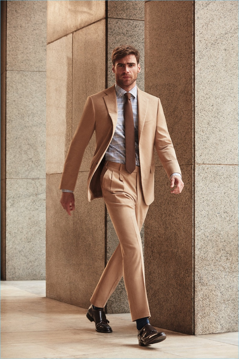 Connecting with Belvest for fall-winter 2018, George Alsford dons a camel-hued suit.