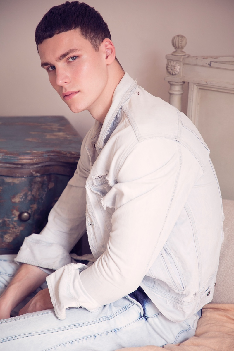 Dima wears jacket Rag & Bone and pants Bottega Veneta.