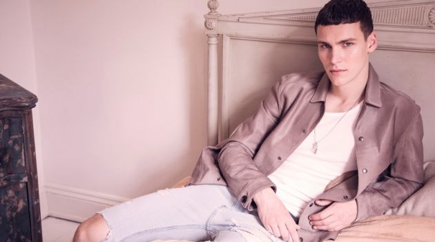 Dima wears jacket Salvatore Ferragamo, tank Dolce & Gabbana, custom jeans Rag & Bone, and necklace Fiorina Jewelry.