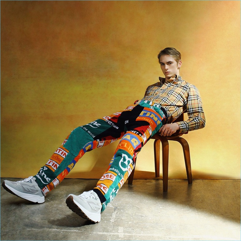Mixing prints, Dominik Sadoch sports a check Burberry shirt with patchwork trousers by Martine Rose and Hi-Tec HTS4 sneakers.