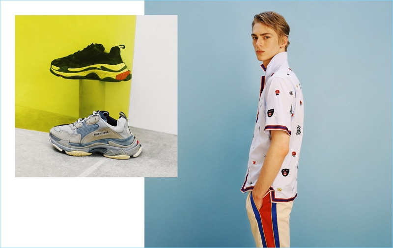 Going sporty, Dominik Sadoch wears a Gucci bowling shirt and trackpants. Pictured left: Balenciaga sneakers.