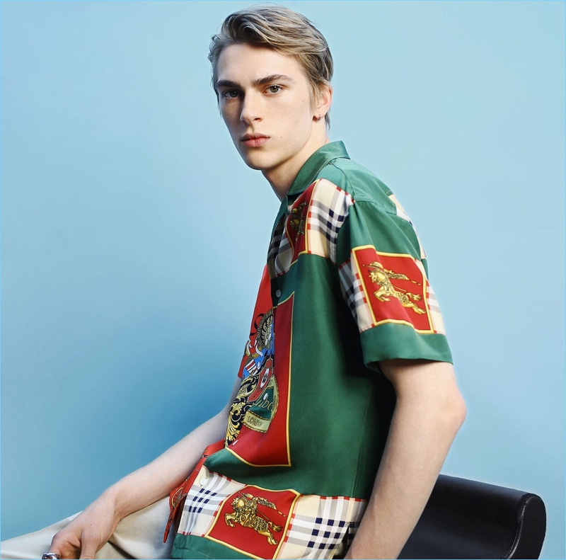 Starring in a style shoot for Matches Fashion, Dominik Sadoch wears a printed silk shirt and trousers by Burberry.