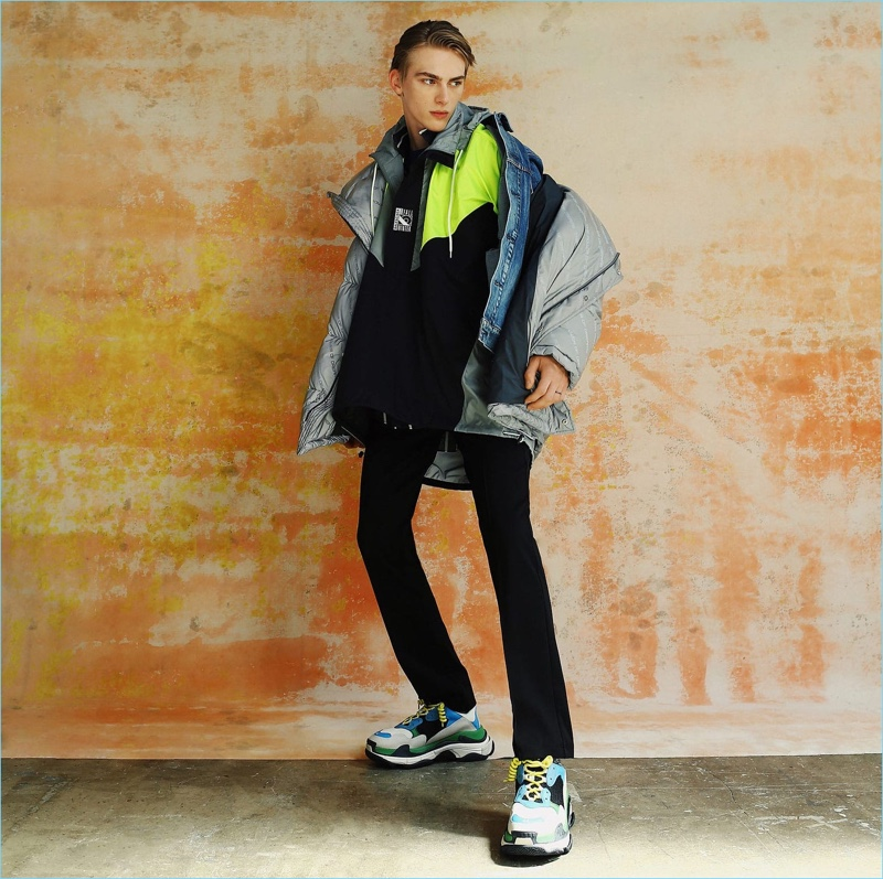 Tapping into the oversized trend, Dominik Sadoch wears a denim jacket, windbreaker, and more from Balenciaga.