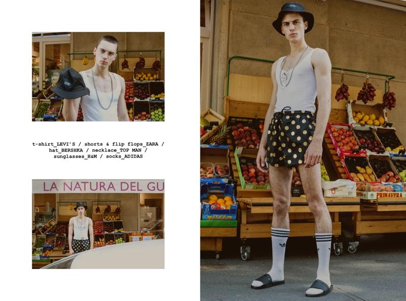 Eugen wears tank Levi's, bucket hat Bershka, necklace Topman, glasses H&M, socks Adidas, shorts and slide sandals Zara.