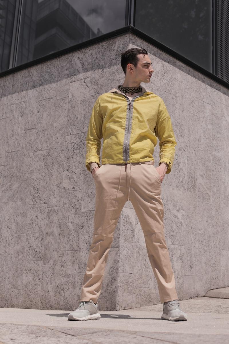 Michelangelo wears sneakers Lumberjacket, trousers Christian Pellizzari, jacket and tie Cividini.