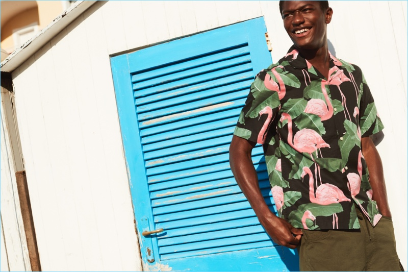 2544781e33f Late Summer Style  3 Effortless Looks from H M. Hamid Onifade reunites with  H M. He wears a relaxed fit flamingo print shirt with cargo
