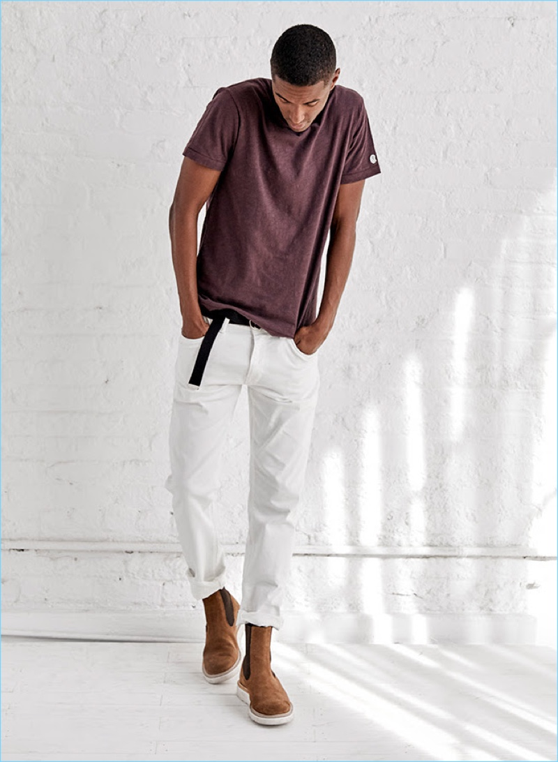 Claudio Monteiro wears a Todd Snyder x Champion t-shirt with the designer's white selvedge jeans. The Portuguese model also dons a Todd Snyder double ring leather belt and Tricker's x Todd Snyder Chelsea boots.