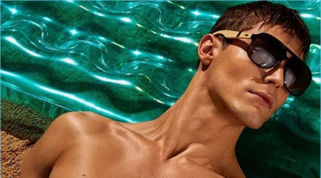 Model Jacob Hankin soaks in the summer sun for Steve Madden's campaign.