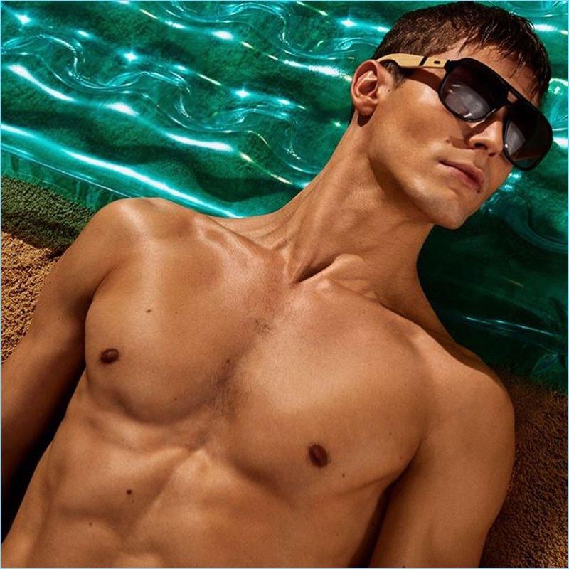 Model Jacob Hankin soaks in the summer sun for Steve Madden's campaign.