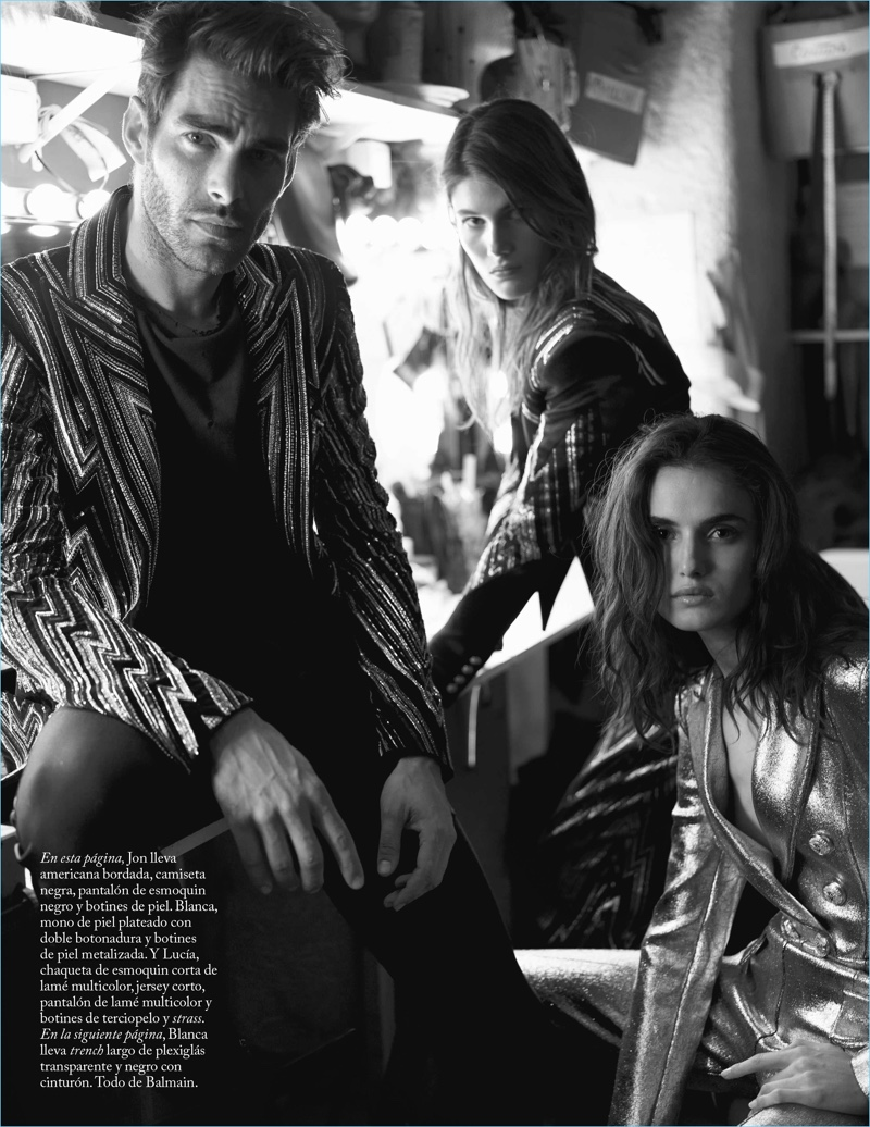 Models Jon Kortajarena, Lucia Lopez, and Blanca Padilla wear Balmain.