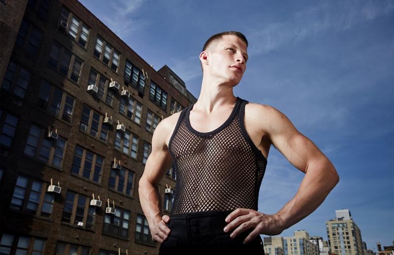 Jordan wears vintage mesh tank J.Lindeberg and pants Dsquared2.