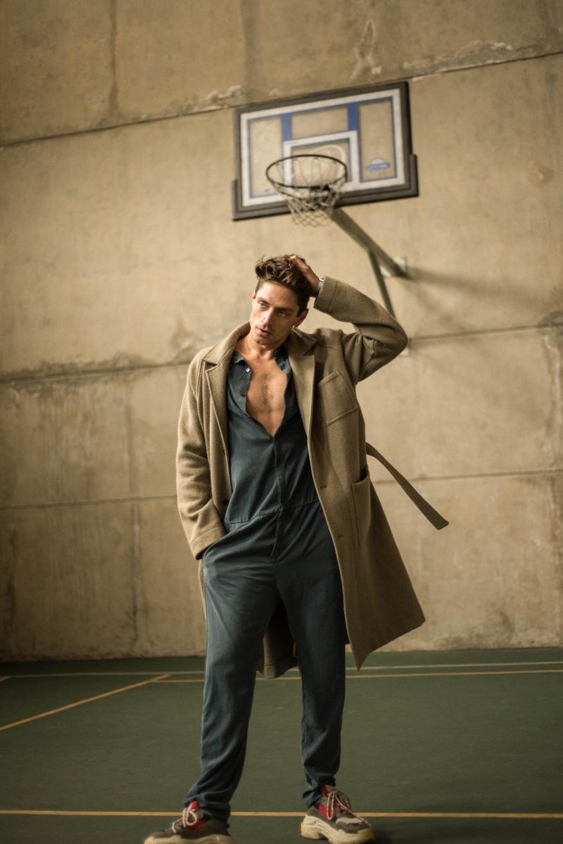 Laurent wears coat HAiKW, jumpsuit Fox Haus, and sneakers Balenciaga.