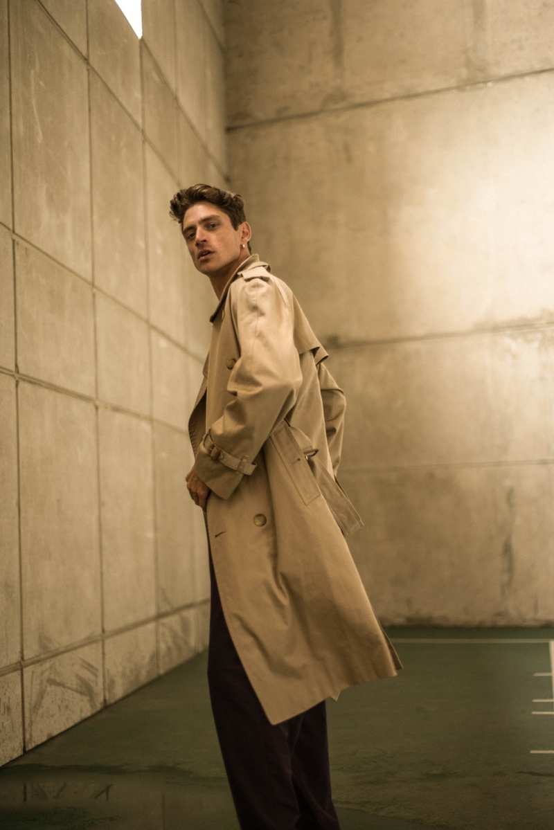 Laurent wears trench coat Burberry and pants Libertine.