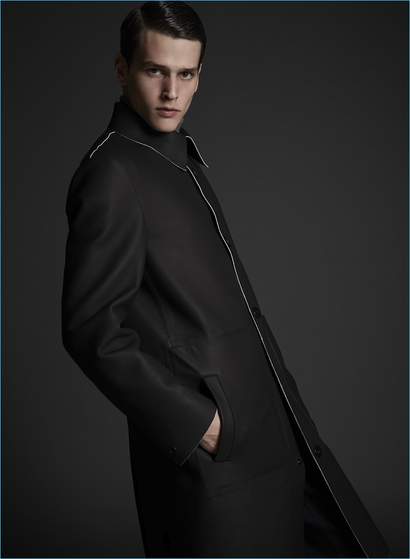 Donning a minimal coat, Simon Van Meervenne is a sleek vision in Major Giovanni Allegri.
