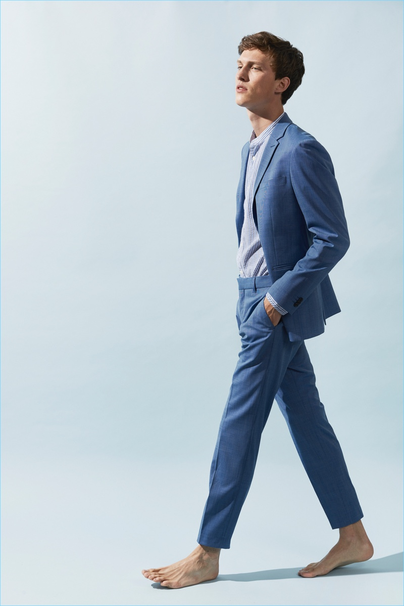 Sporting a sharp blue suit, Malthe Lund Madsen fronts Matinique's summer 2018 campaign.