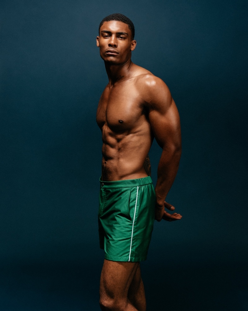 Taejahn wears newport green swim shorts T. Christopher.