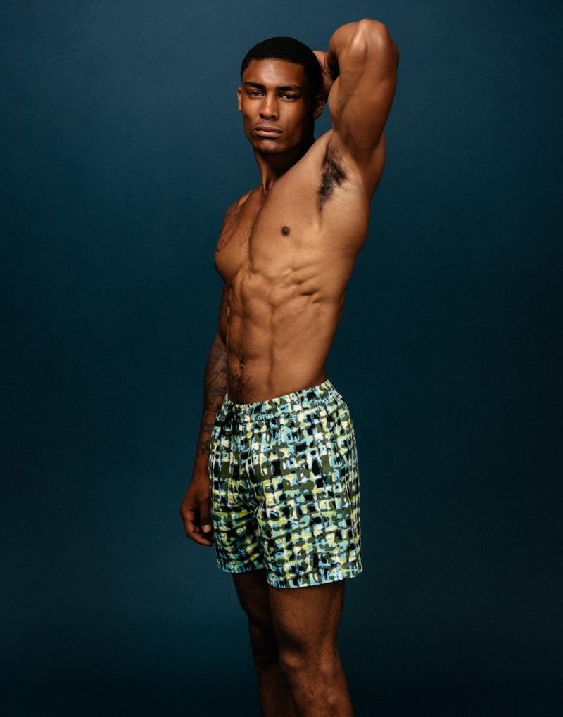 Taejahn wears nantucket tie dye swim shorts T. Christopher.
