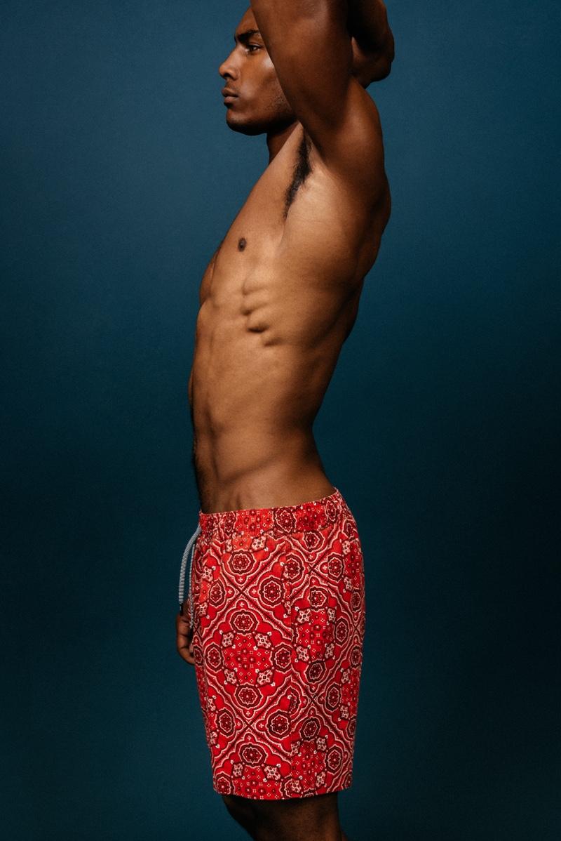 Taejahn wears red bandana swim shorts Reyn Spooner.