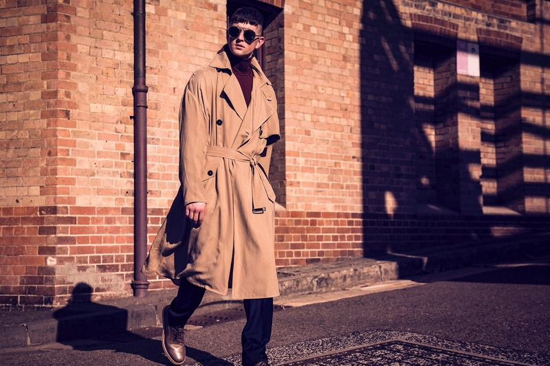 Michael wears trench coat and sunglasses Giorgio Armani,  knitwear and pants P Johnson Tailors, and shoes Salvatore Ferragamo.