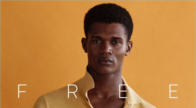 Embracing a pop of color, O'Shea Robertson wears a yellow polo from Massimo Dutti.