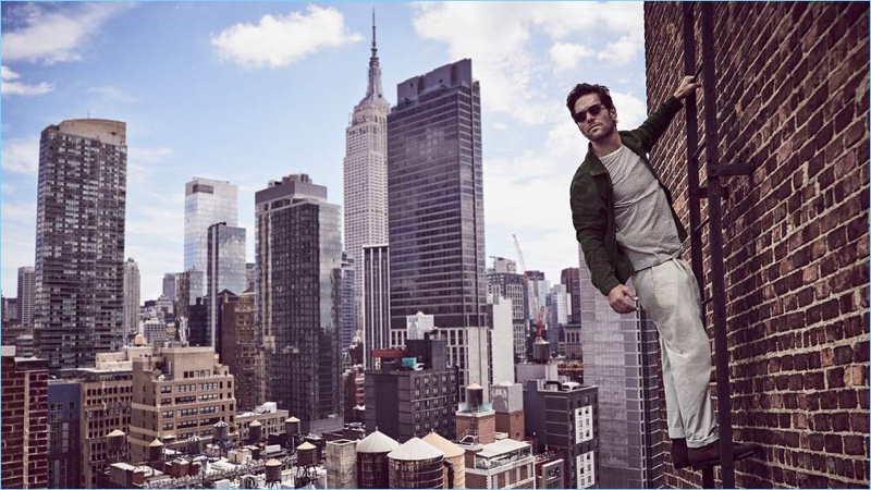 Paul Rudd wears an AMI suede shirt jacket and Oliver Spencer t-shirt. He also sports Mr P. chinos, Officine Creative suede boots and Jacques Marie Mage sunglasses.