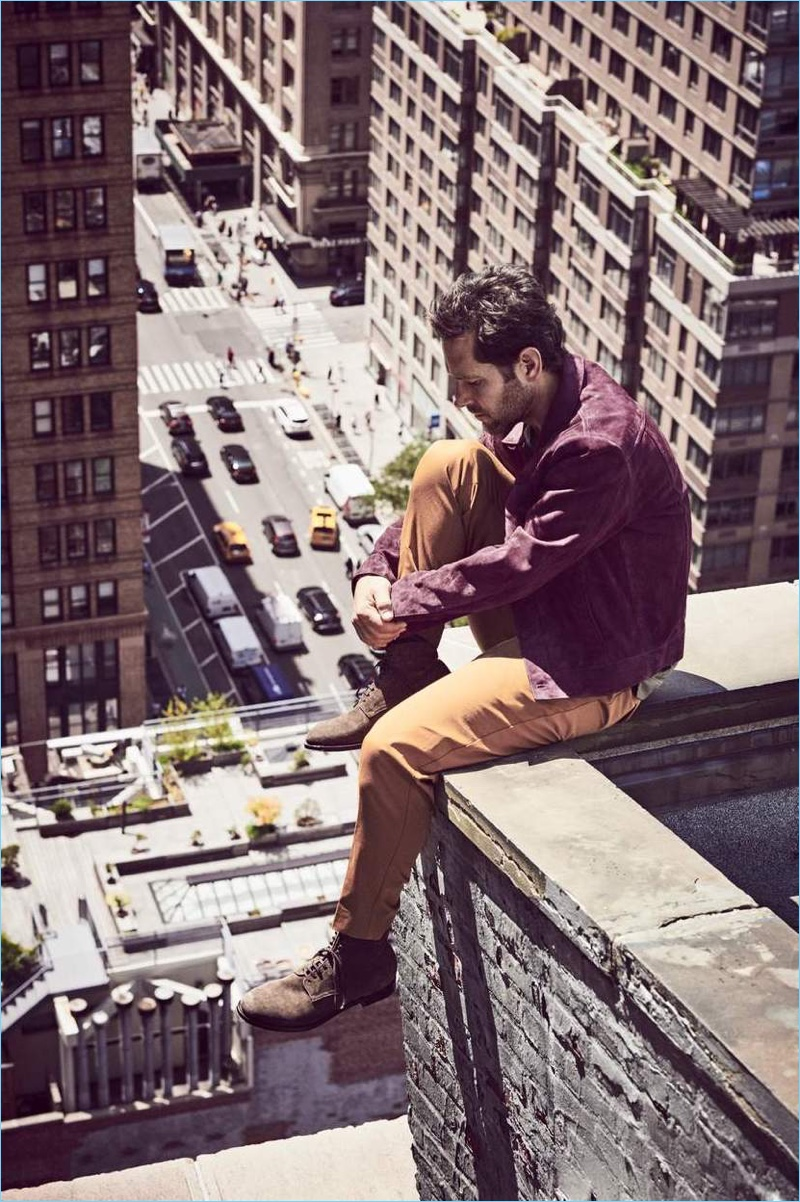 Overlooking New York, Paul Rudd wears a Berluti suede blouson jacket, Massimo Alba t-shirt, and Sandro cropped trousers. Officine Creative suede boots complete his look.