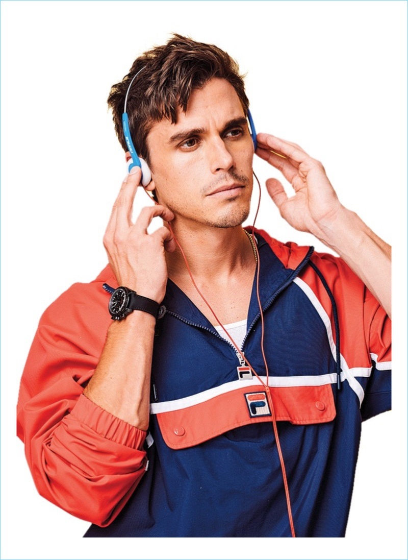Antoni Porowski sports a Fila jacket in a new photo shoot.