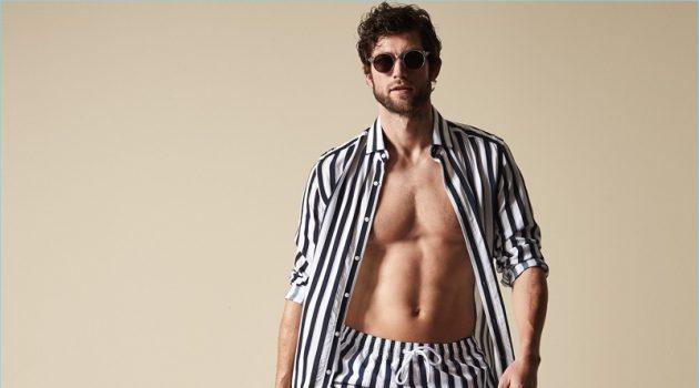 Making a striped statement, Jan Trojan wears Reiss' Flint stripe swim shorts in navy.