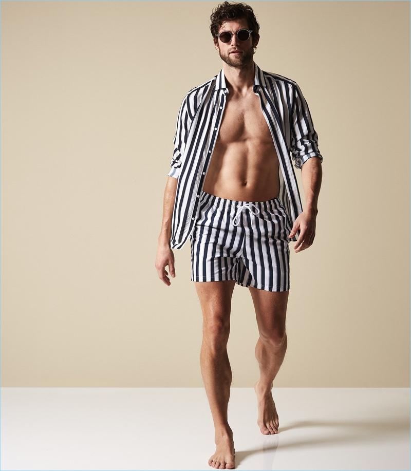 77afdd2e50 Making a striped statement, Jan Trojan wears Reiss' Flint stripe swim shorts  in navy