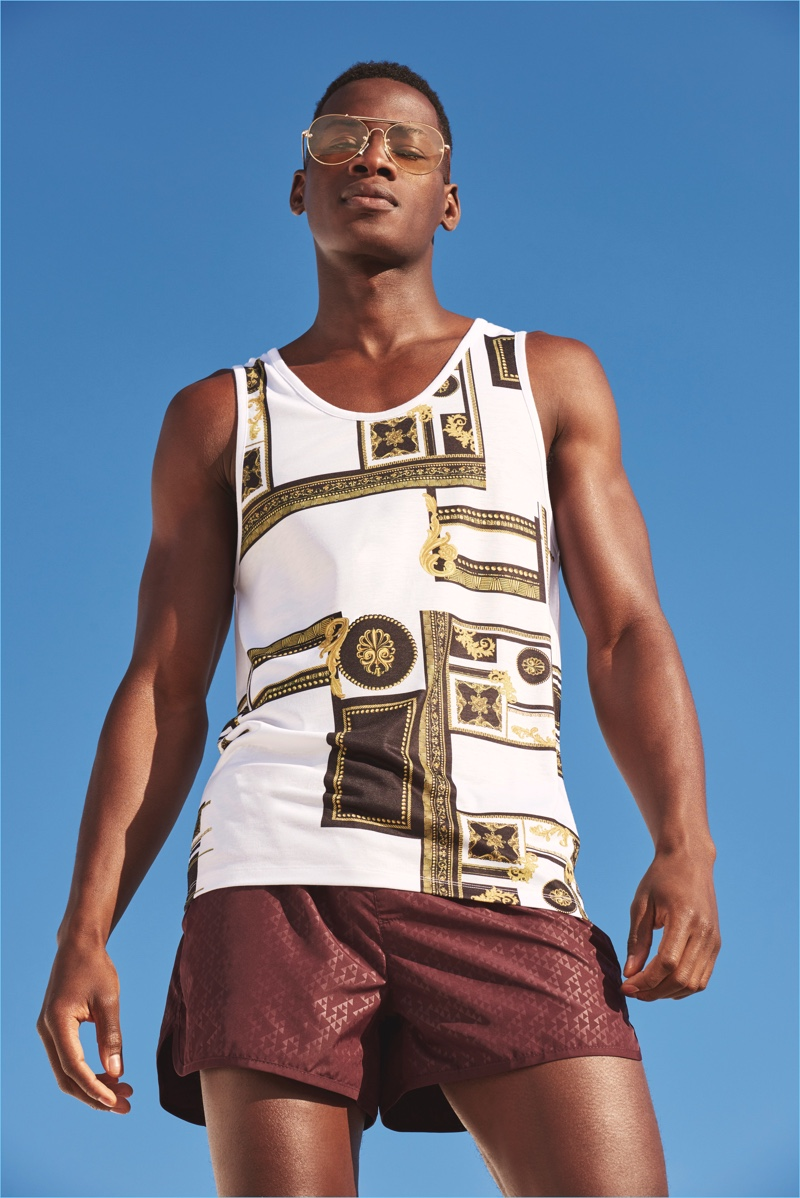 bcdcf80e27c Model David Agbodji is a summertime vision in a tank and swim shorts from River  Island