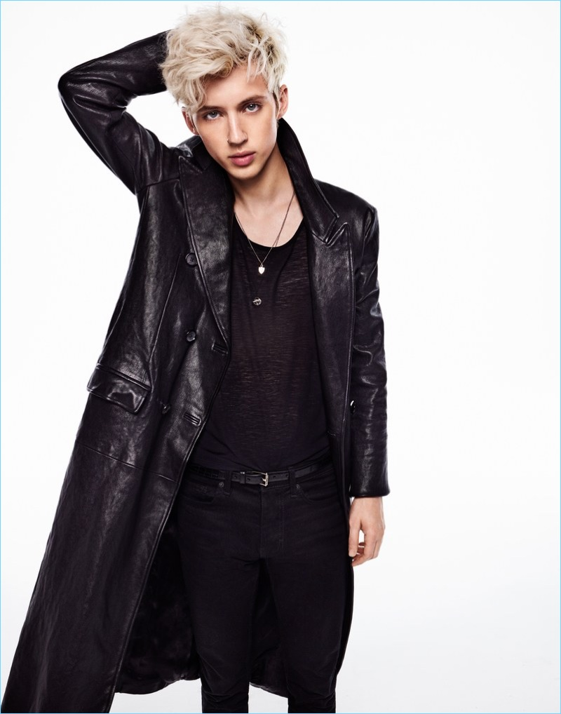 Clad in an Alexander McQueen leather coat, Troye Sivan also wears a Saint Laurent tank and Topman jeans.