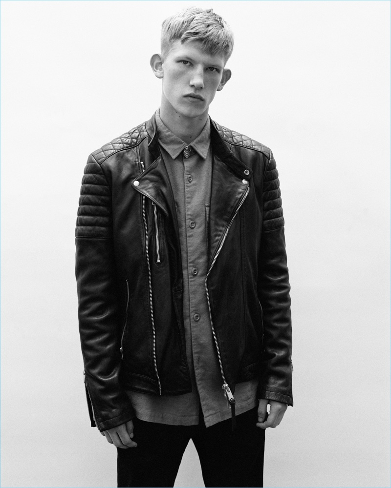 Sporting a leather biker jacket, Connor Newall appears in AllSaints' fall 2018 campaign.