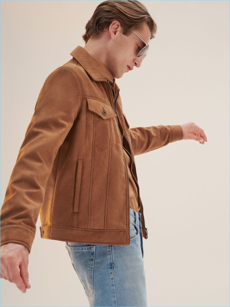 Donning a suede jacket, Anatol Modzelewski models a look from Reserved.