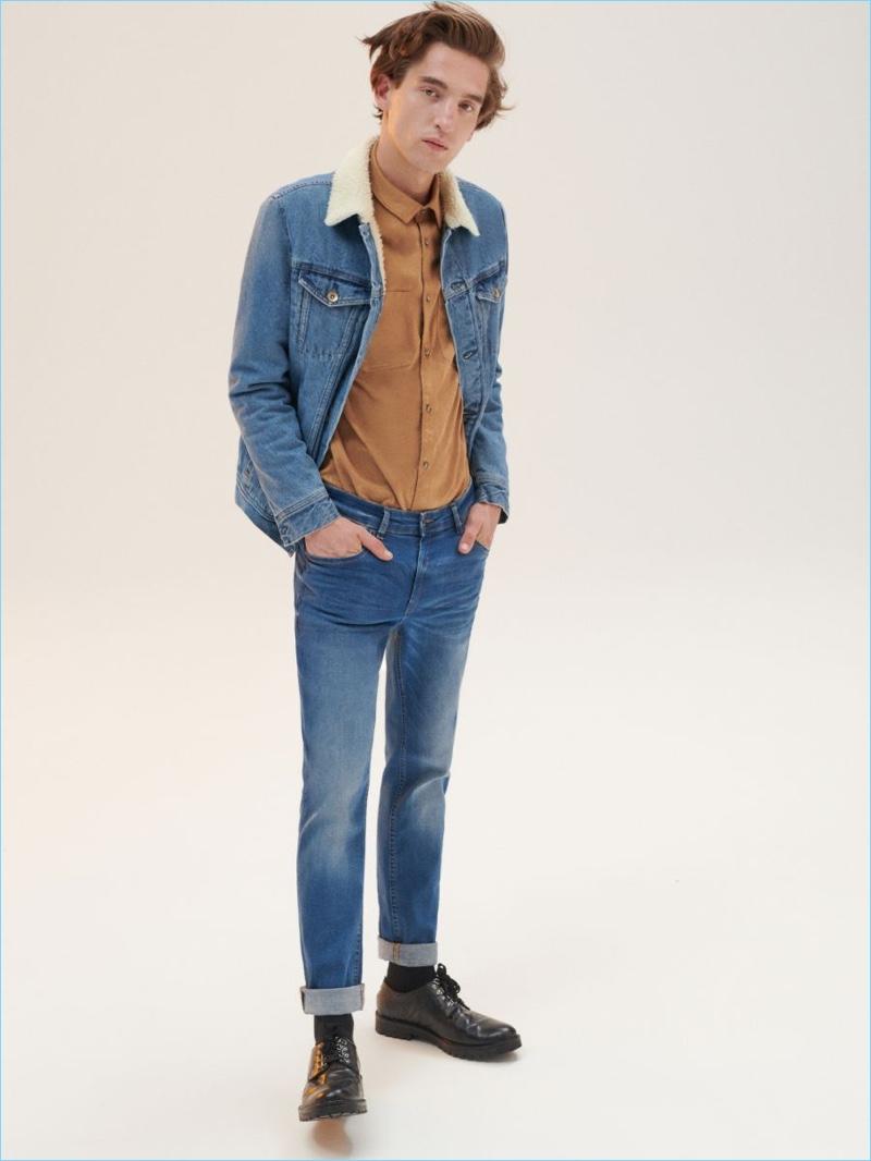 Polish model Anatol Modzelewski wears denim fashions from Reserved.