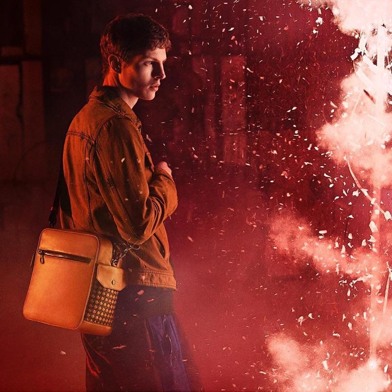 Delivering a side profile, Tim Schuhmacher appears in Bottega Veneta's fall-winter 2018 campaign.