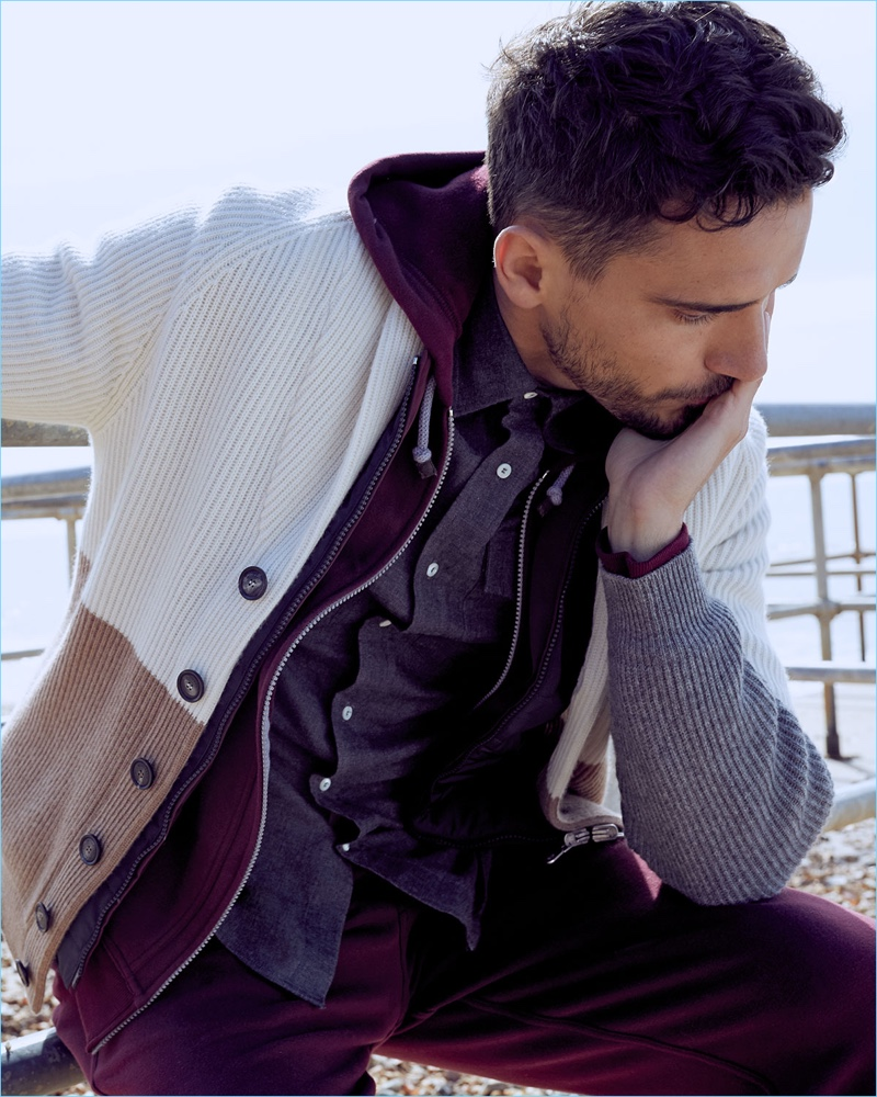 Connecting with Neiman Marcus, Arthur Kulkov wears a Brunello Cucinelli quilted vest, hoodie, shawl cardigan, pants, and shirt.