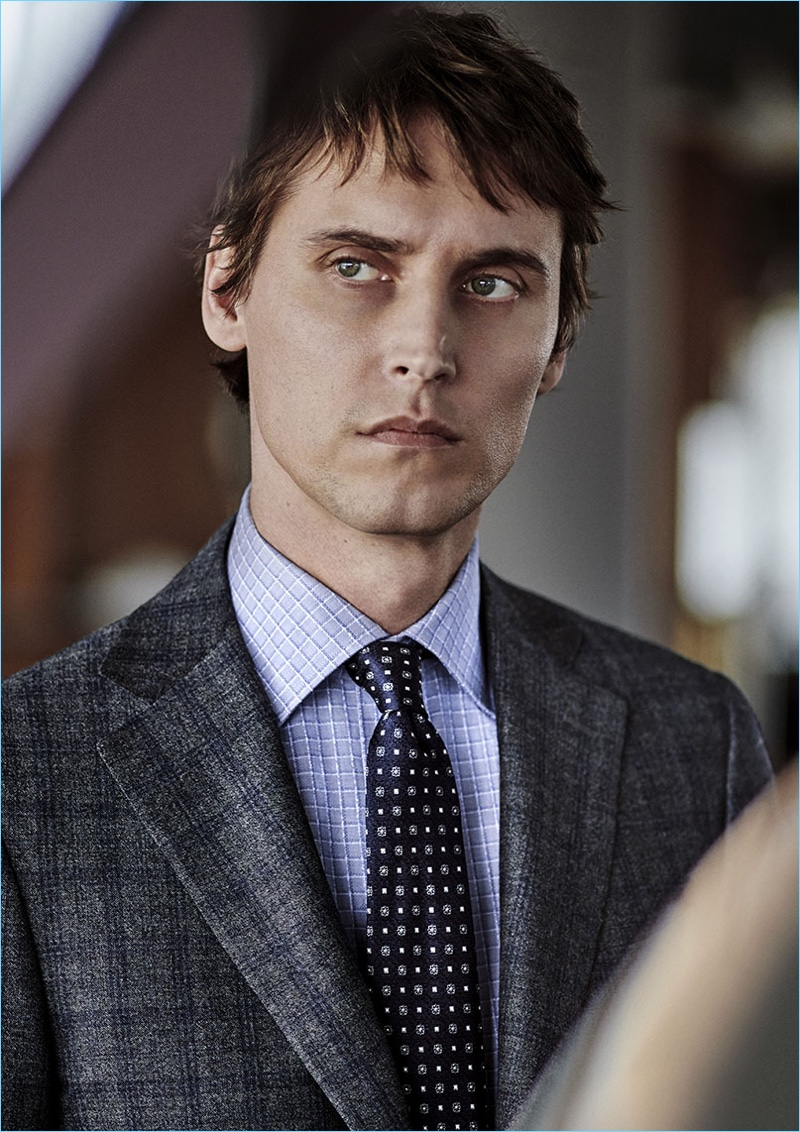 French model Sébastien Andrieu wears a sharp suit, shirt, and tie by Canali.