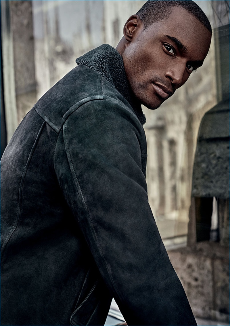 Corey Baptiste dons a suede and shearling jacket from Canali's fall-winter 2018 collection.
