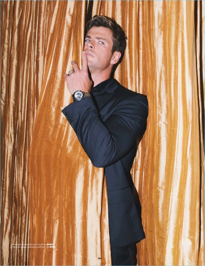 Posing for a cheeky photo, Chris Hemsworth appears in the latest issue of Esquire Singapore.