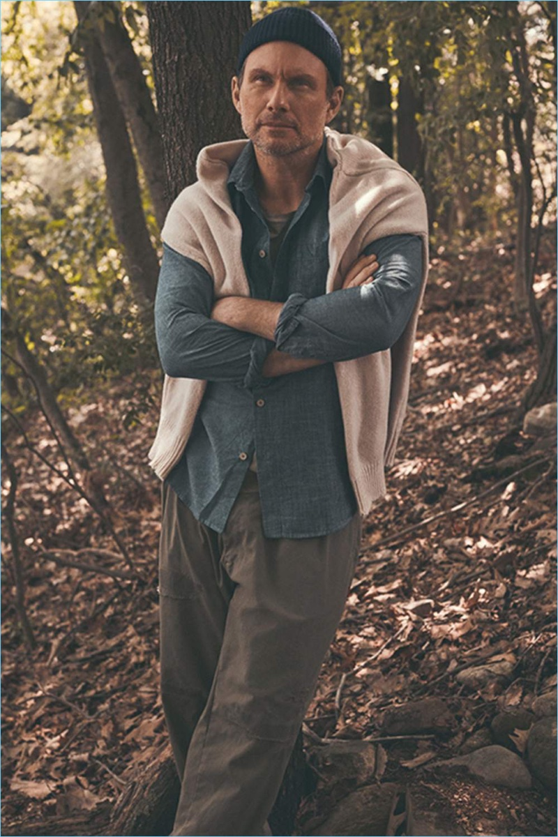 Venturing outdoors, Christian Slater wears a Maison Margiela sweater, Folk chambray shirt, Enlist t-shirt, Beams trousers, and a beanie by Anderson & Sheppard.